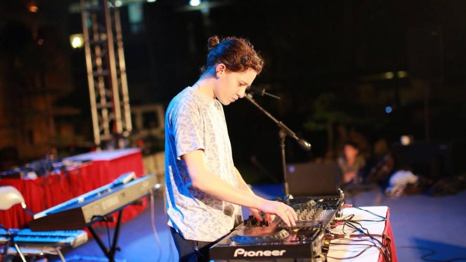 Micachu Performing a DJ set on a festival stage