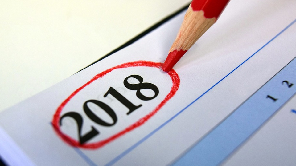 The number 2018 circled with red pencil at the top of a calendar