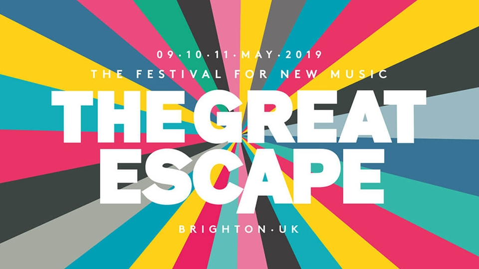 Multi-coloured background with Great Escape text overlayed