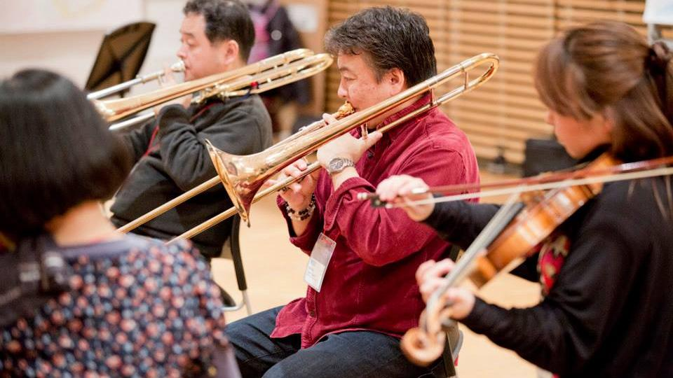 Orchestral musician plays the trombone